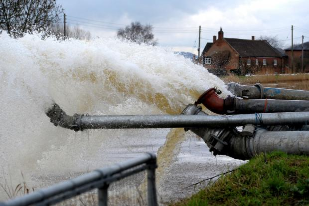 Floodwater is pumped into the River Parrett at the Saltmoor Pumping Station near Burrowbridge in Somerset last month