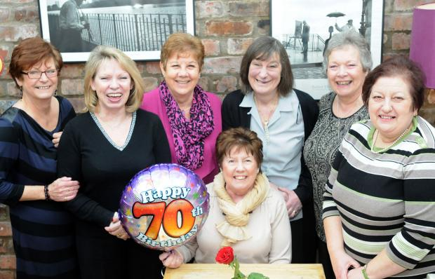 York Press: Former Rowntree workers meet up at Wildes bar in York for their reunion and to celebrate Audrey Scott's 70th birthday; from left,  Barbara Blanchard, Frances Fisher, Sandra Taylor, Audrey Scott (seated), Pat Hanks, Josie Dobson and Margare