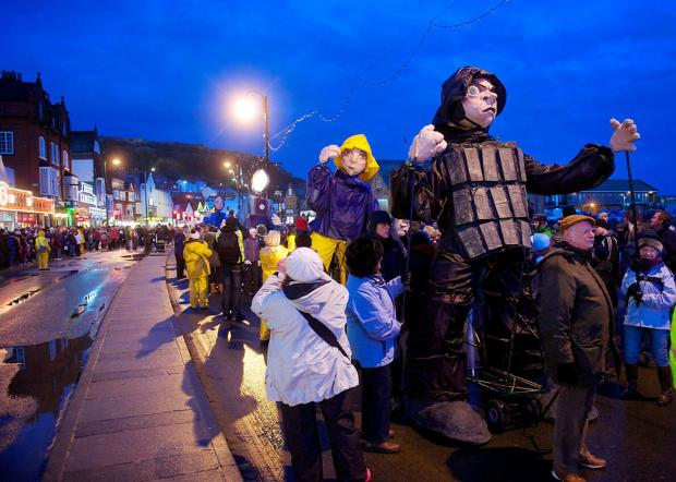 Scarborough's South Bay draws a large crowd to watch a procession of giant puppets as part of the Coastival festival
