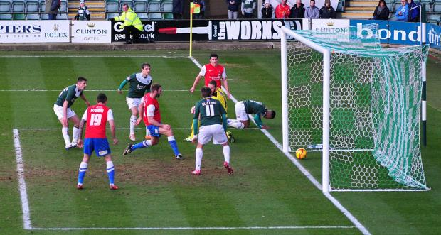 York City's John McCombe stabs in his second goal during the 4-0 victory against Plymouth at Home Park