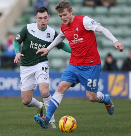 On-loan winger  Will Hayhurst on the ball during  the Minstermen's 4-0 victory over Plymouth Argyle
