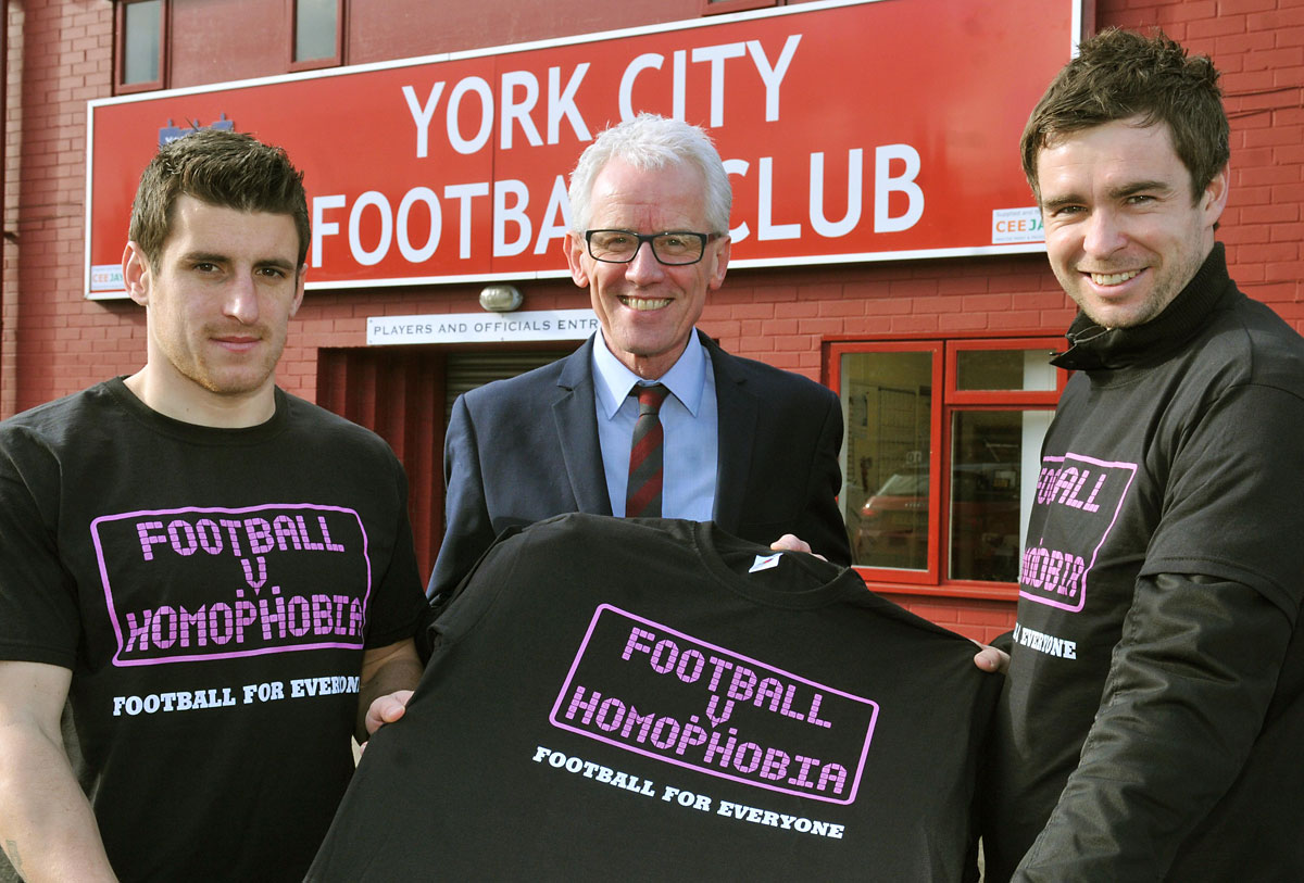 Paul Keenan of Benenden Health holds a T-shirt marking Saturday's game  with players Michael Coulson, left, and Dave McGurk