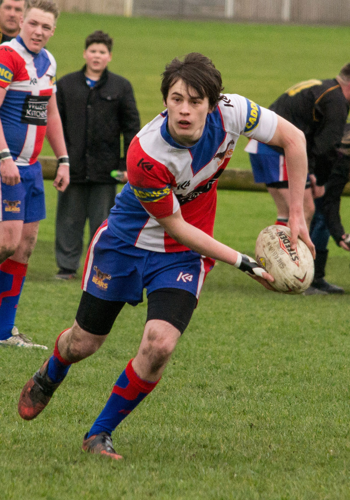 Full-back Ben Pugh launches a Sherburn Bears' attack