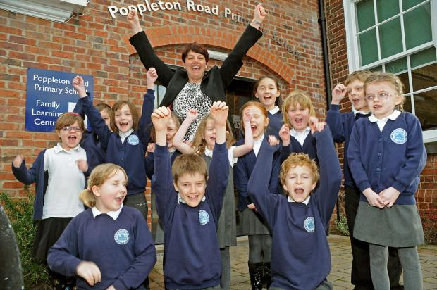 Poppleton Road School head teacher Debbie Glover with some of her pupils  celebrating the results of their Ofsted report