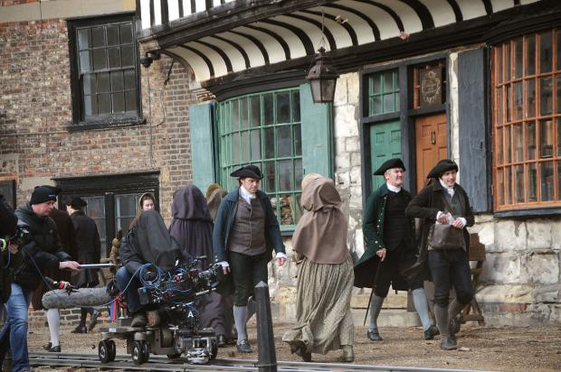 York Press: Actors walk past St William's College as filming gets under way on Jonathan Strange & Mr Norrell
