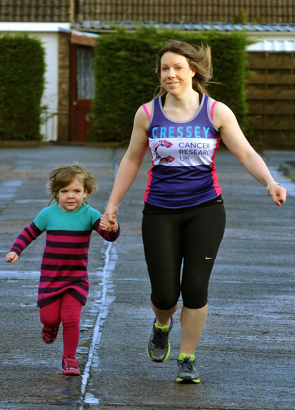 Hannah Cressey, who is running in the London Marathon,  jogging with her three-year-old  daughter Frances at Stockton-on-the-Forest