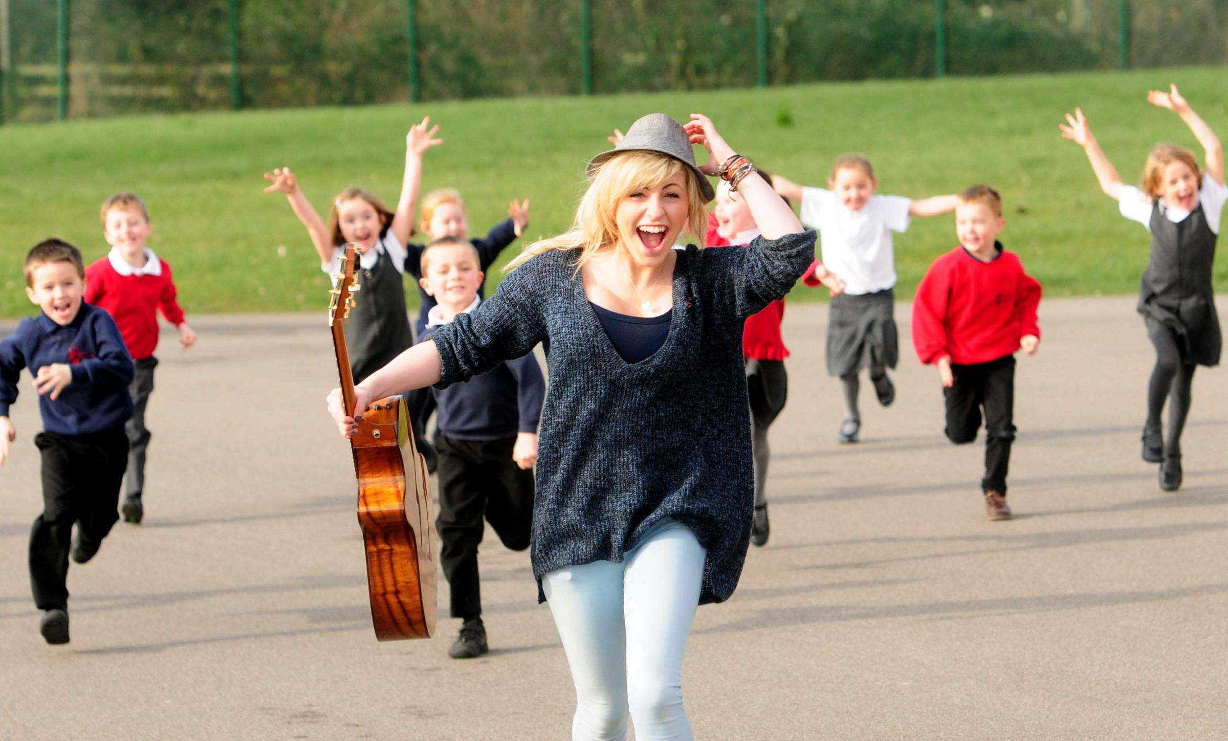 The Voice contestant Beth McCarthy performs for York primary school pupils