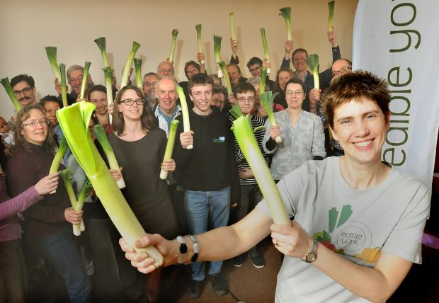 Trustee Vikki Pendry and members of Edible York wave their leeks as they launch A Year Of Action event at their annual general meeting at the Friends Meeting House