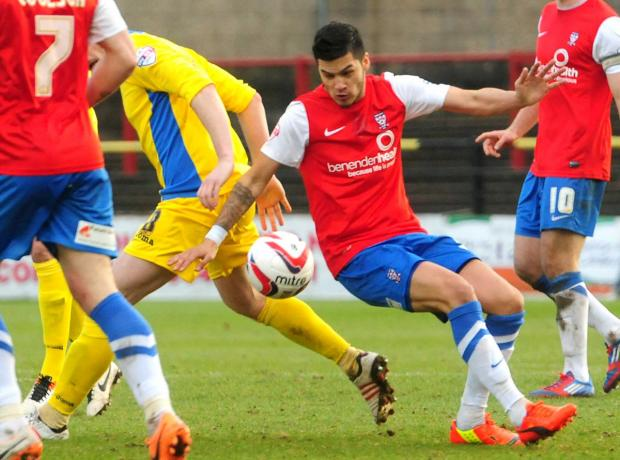 York City midfielder Adam Reed, pictured centre, battling for possession, is keenly anticipating a return to play in front of a sizeable crowd at Fratton Park tomorrow