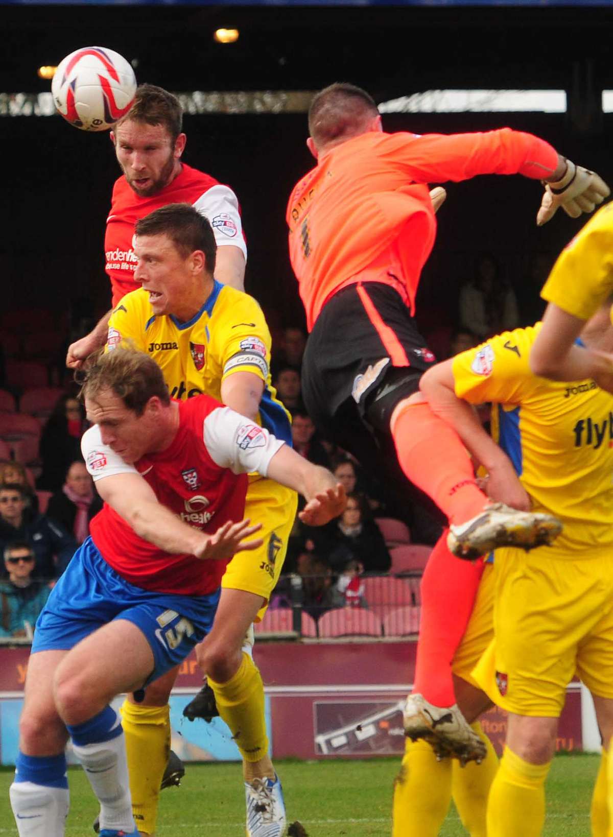 Centre-back John McCombe heads York City into the lead against Exeter at Bootham Crescent