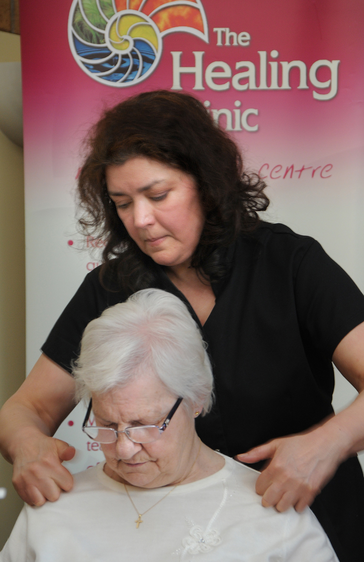 Barbara Smith of the Healing Clinic gives a shoulder massage to Louisa Littler at the City Mills Centre