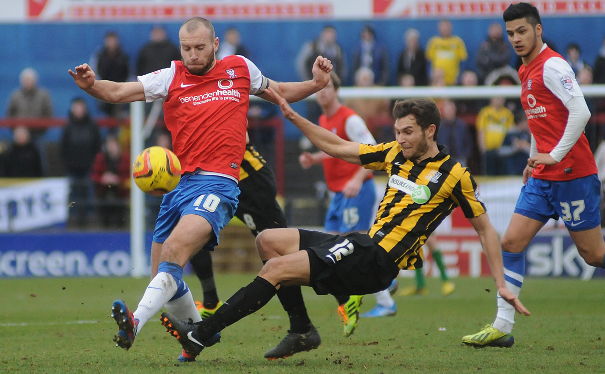 York City skipper Russell Penn, left, and central midfield partner Adam Reed, right, in action at Bootham Crescent