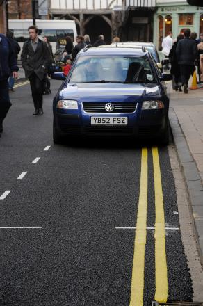 Confusion over double yellow lines in parking bays  in Goodramgate
