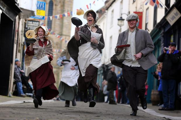 York Press: Runners take part in the annual pancake race in Ripon