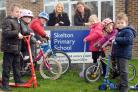 Skelton Primary School's head teacher,  Alison Halley, centre right, and the school's Bike It champion, Miriam Gunn, with pupils.
