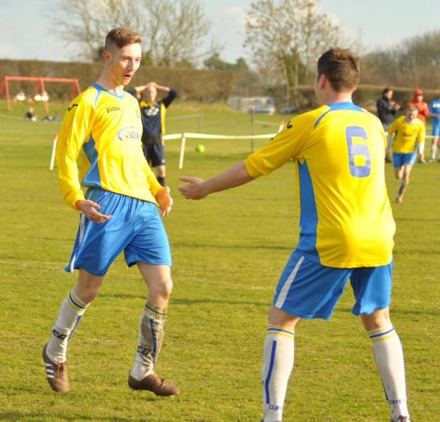 Cliffe's Ryan Sedman, left, celebrates making it 2-0 against Barmby Moor in the East Riding FA Qualifying Cup