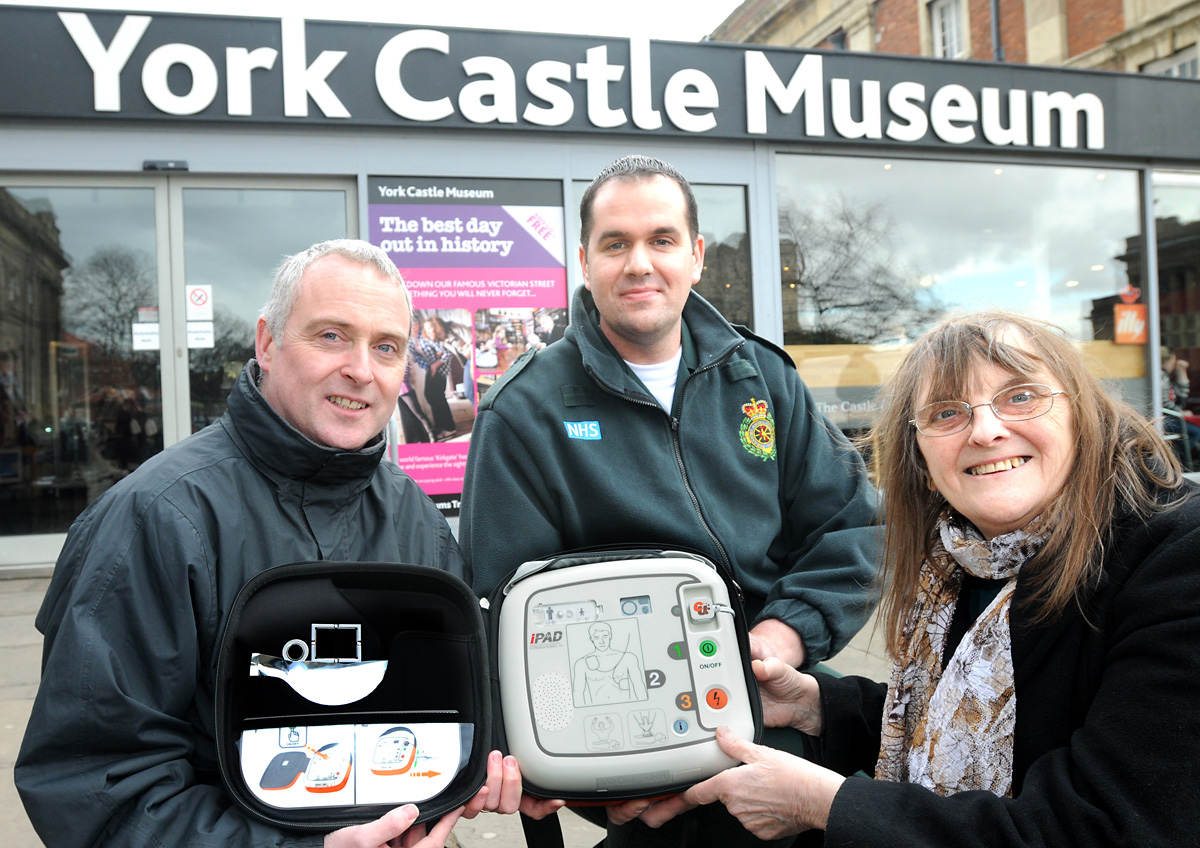 David Armstrong, left, of the Castle Museum at the presentation with community defibrillator trainer Warren Bostock and Pat Gardner, who donated the machine in memory of her husband