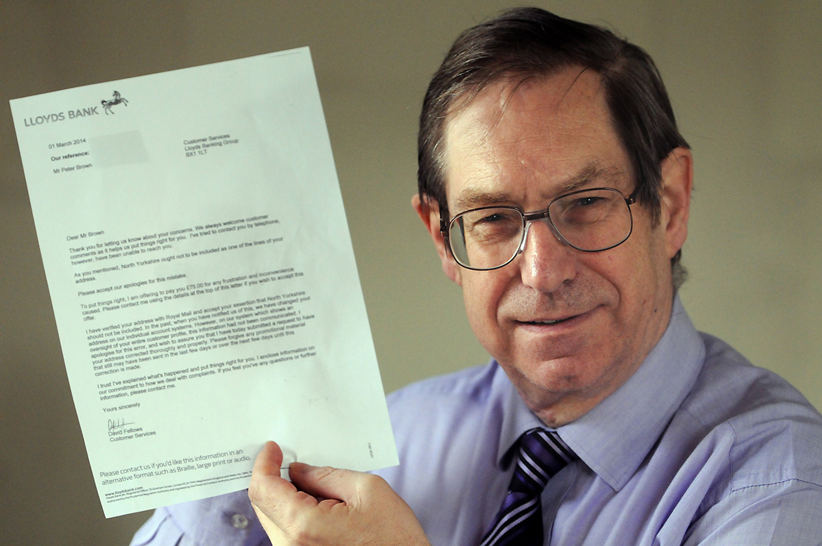 Peter Brown with a letter he was sent by Lloyds Bank relating to his concerns about his address in York  and not North Yorkshire
