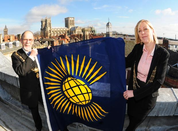 The Lord Mayor of York, Coun Julie Gunnell, and the Sheriff of York, Coun Brian Watson, prepare to raise the Commonwealth flag above the Mansion House