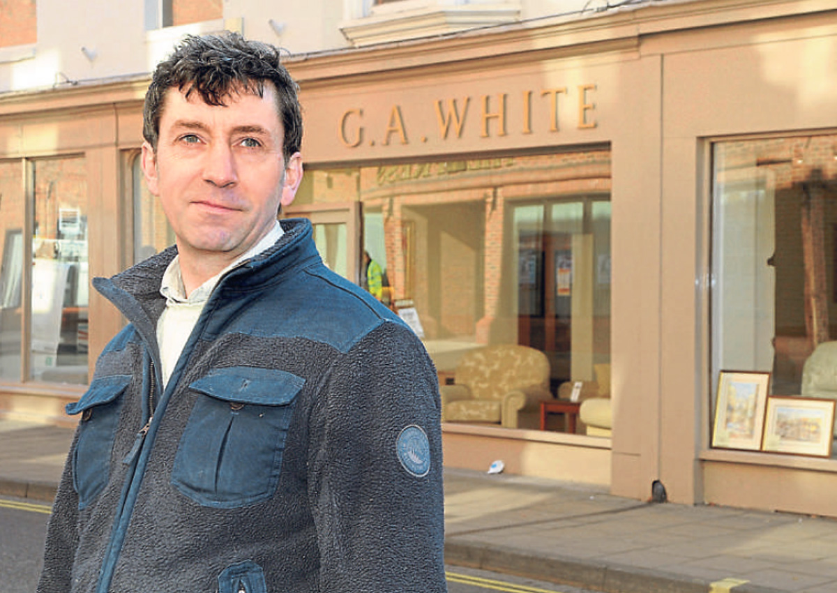 David White outside the family furniture shop in Walmgate which is set to close. Picture: David Harrison.