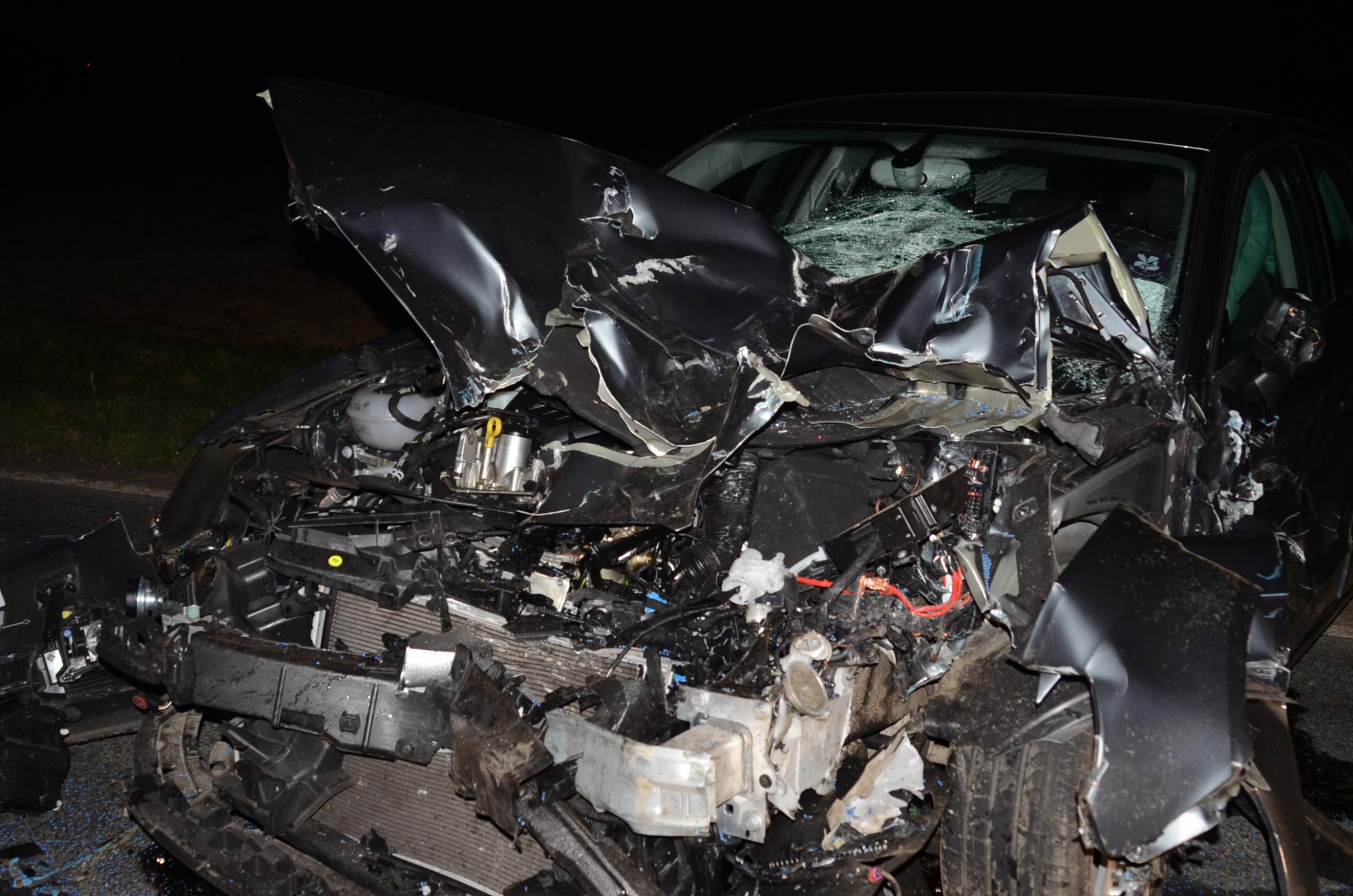 Woman escapes injury as car and tractor crash