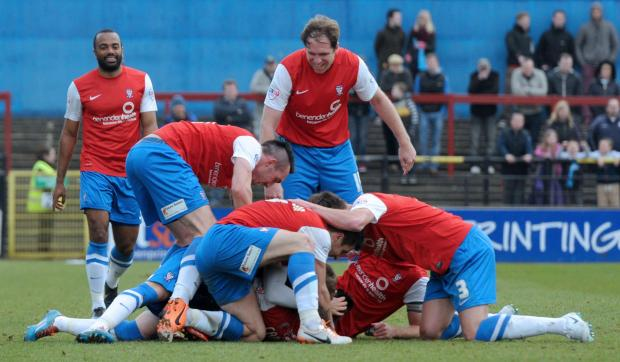 York City players celebrate Josh Carson's goal in the 2-0 win over Wycombe