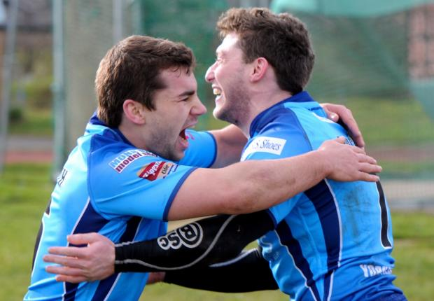 ALL SMILES: Pat Smith, left, and Jonny Presley's celebrate after the latter finished off a try-of-the-season contender set up by Greg Minikin