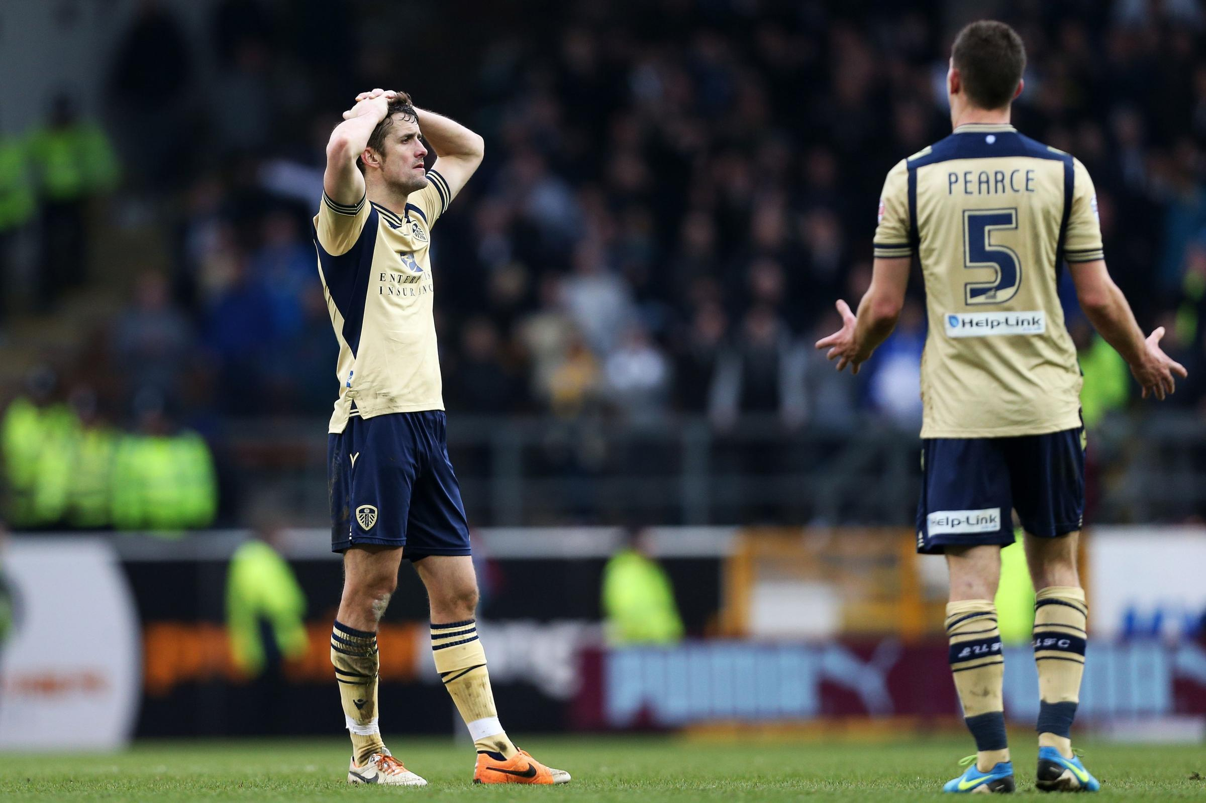 Leeds United's Luke Murphy and Jason Pearce react after losing the Sky Bet Championship  match at the Turf Moor, Burnley. PRESS ASSOCIATION Photo. Picture date: Saturday March 15, 2014. See PA story SOCCER Burnley. Photo credit should read: Lynne Came
