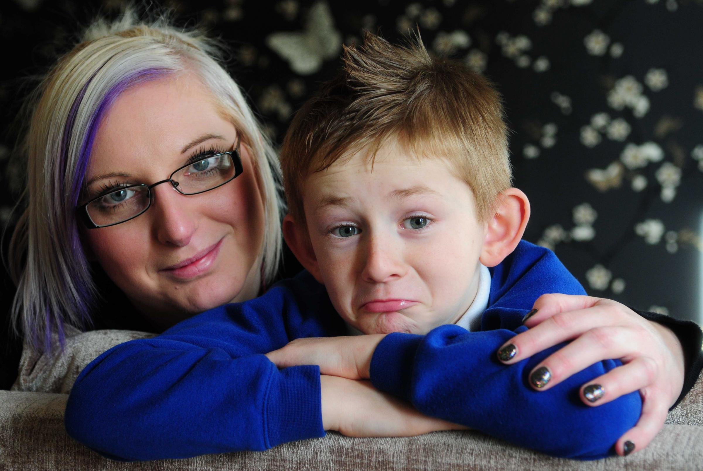 Kara Palmer with her son Riley, who is having to travel 20 miles a day to attend school