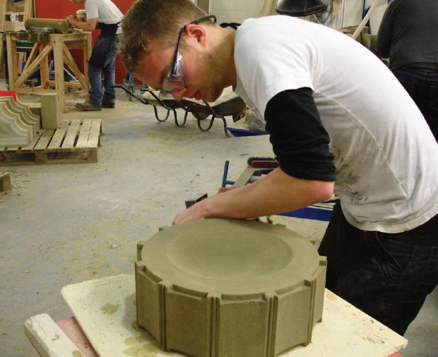 Sam Turner, a stonemasonry apprentice at York Minster, works on the memorial.