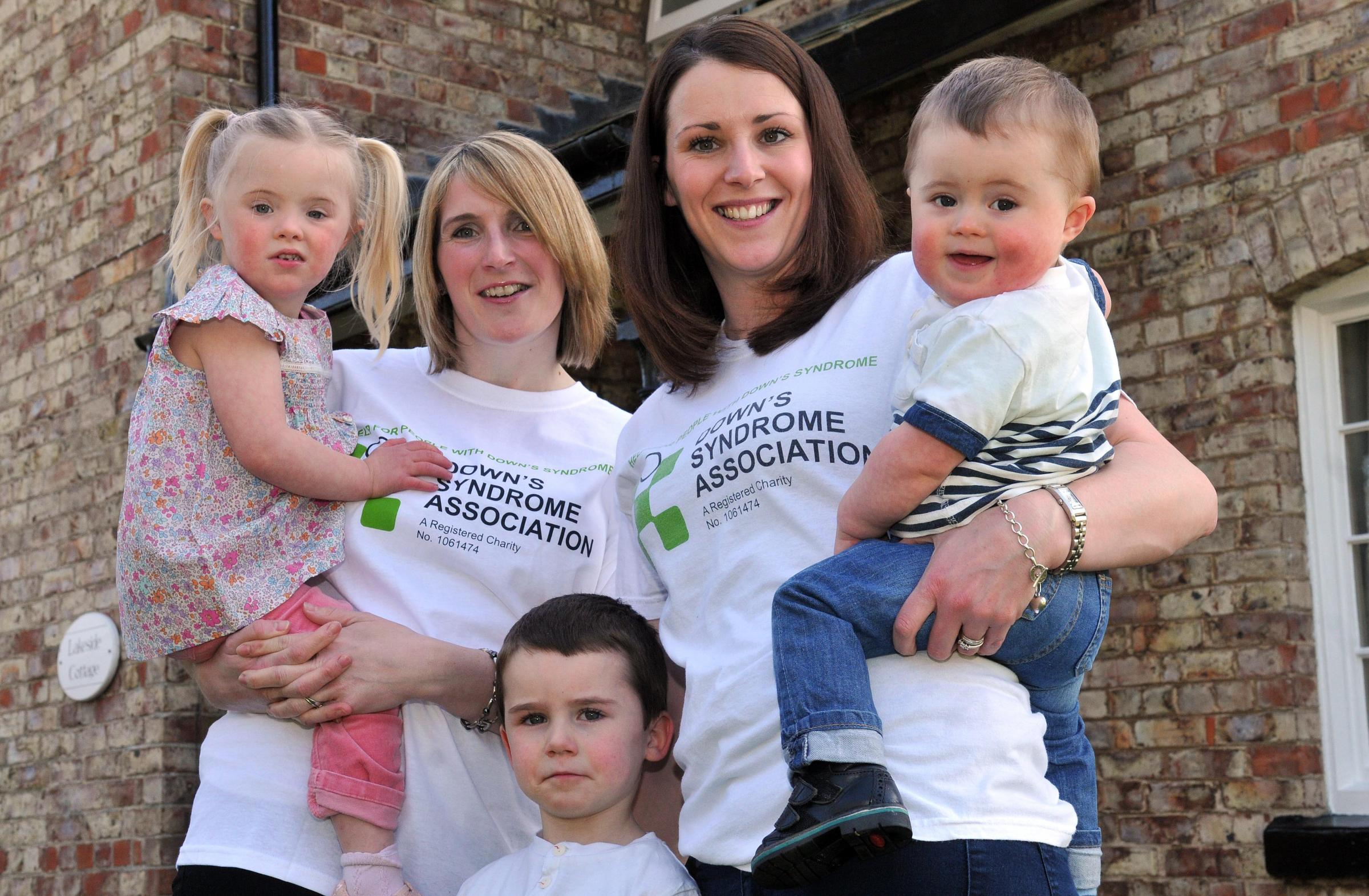 FAMILY WEEK: Mums Emily Webster, left, with her daughter Freya, aged three, and Laura Massheder, with her sons Zac, one, and Harry, four, promote the Down's Syndrome Awareness Week Picture: Nigel Holland