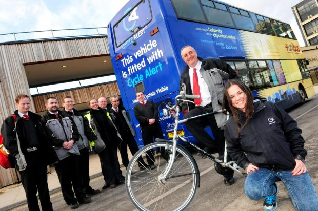 York Press: Danni Lapham of Cycle Alert with Pete Cammidge and fellow bus drivers at the University of York.