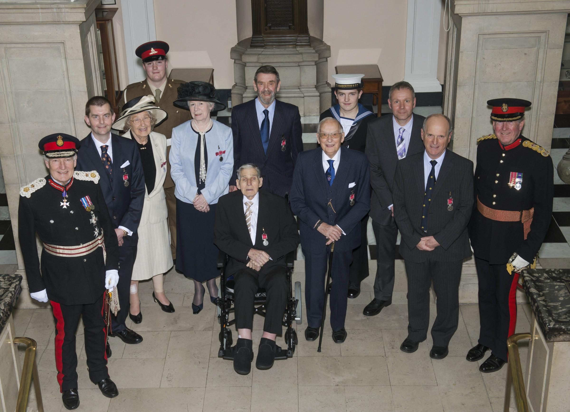 Volunteers receive their awards from The Lord Lieutenant The Lord Crathorne KCVO (left) and The Vice Lord Lieutenant: Brigadier Wardle OBE (right).