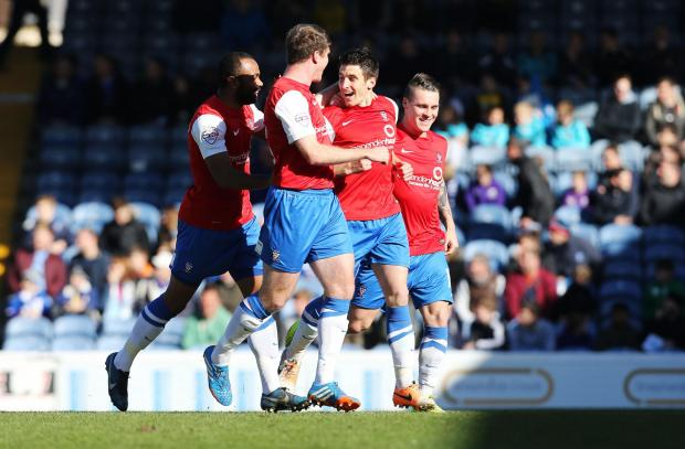 York City forward Michael Coulson celebrates his match-winner at Portsmouth in Sky  Bet League Two