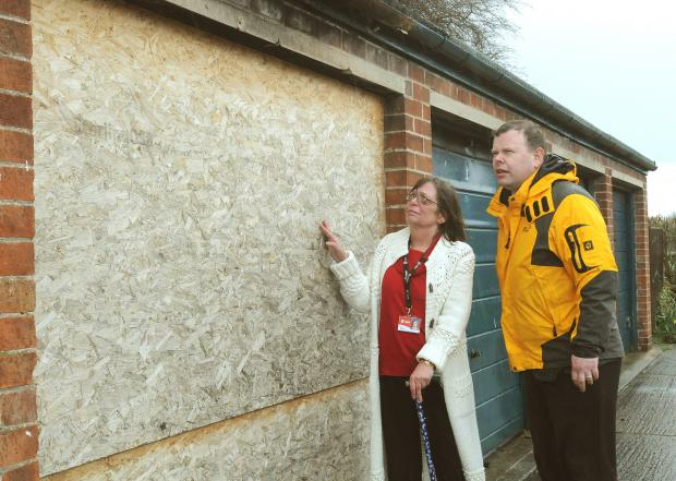 Councillor Lynn Jeffries and former council leader Andrew Waller with a derelict garage on Beverley Court, off Windsor Drive in Acomb, York