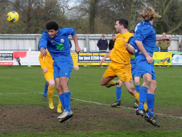 Tadcaster Albion (yellow) v Pickering Town (blue). Pictured is Tadcaster's Matthew Sparkes scoring his second headed goal. Picture David Harrison. (4908918)