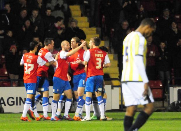 York City's players celebrate Will Hayhurst's deflected winner against Torquay