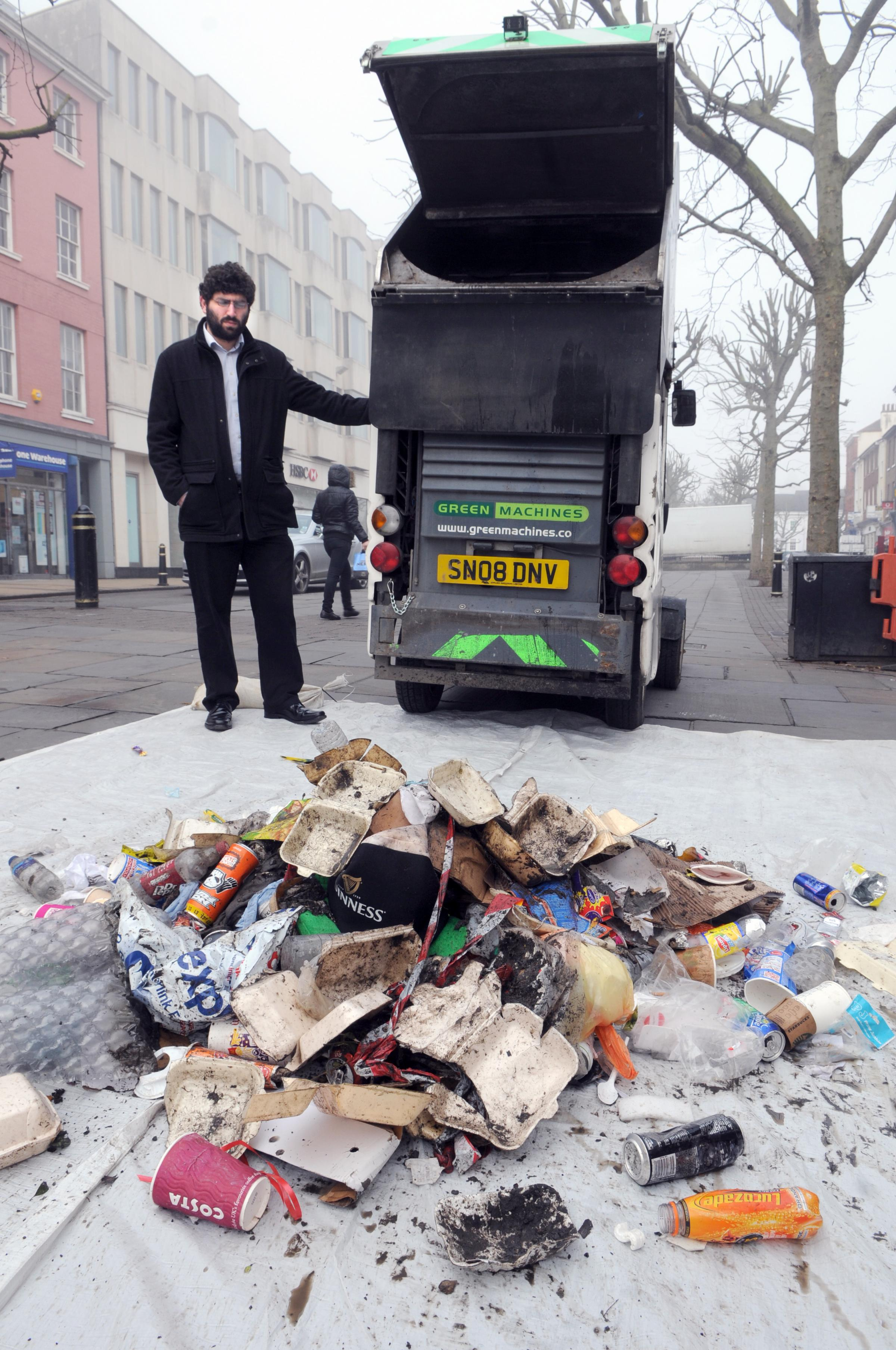 Coun David Levene, City of York Council's cabinet member for Environmental Services, views the litter collected by one mechanical sweeper, on display in Parliament Street