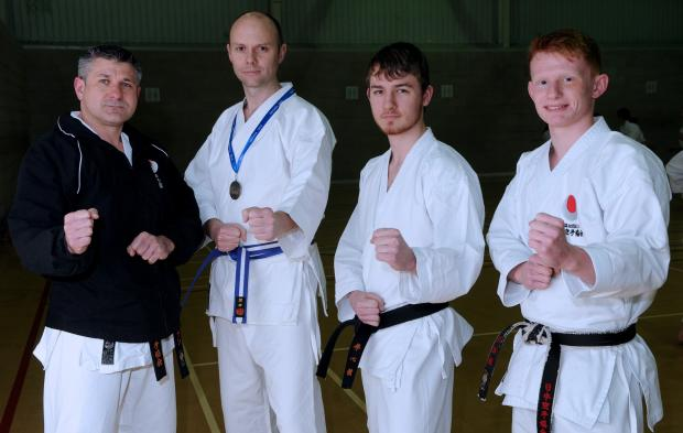 Kenshinkan Karate Club instructor Ian Tate, left, with, from left, Andy McClements, Aron Blair and Alistair BevanPicture: Mike Tipping