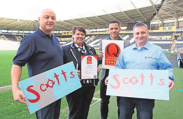 Scotts of Helmsley owner Tony Webster (far left) and chef manager Shane Wight (far right) are presented with their award by Tracy Poskitt and Liam Rosenior