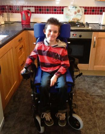 Alex Mason, 9, who needs a new wheelchair to be able to play powerchair football.