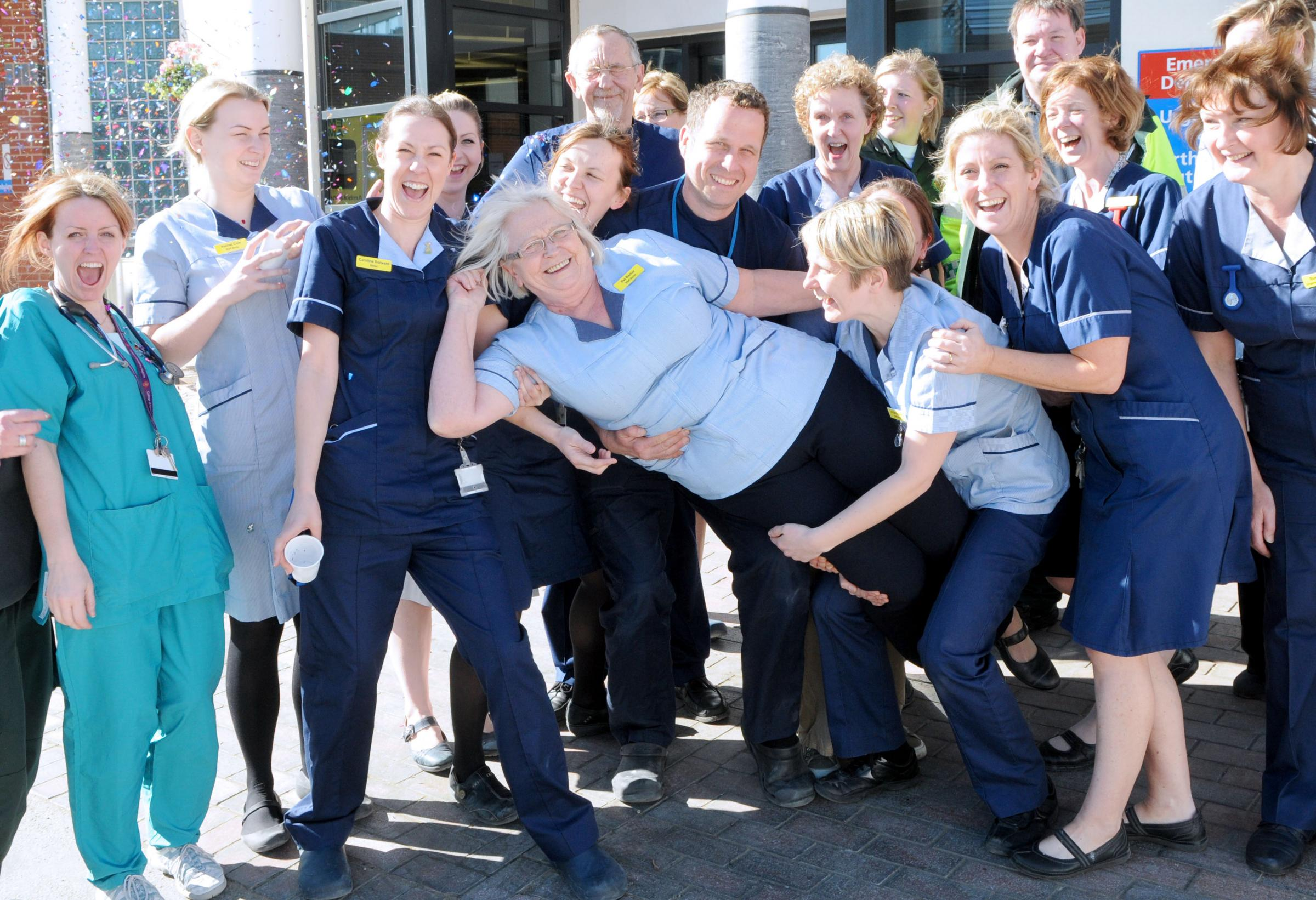 Pat Barker is carried out of the Emergency department, by some of her colleagues, at York Hospital.