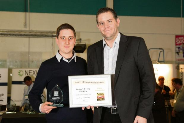 York Press: Tom Fozard (left) collects one of the two Design Awards won at SIBA BeerX.