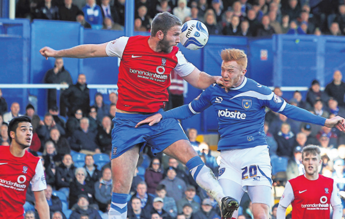 York City centre-back John McCombe is imperious in the air in the recent 1-0 win at Portsmouth