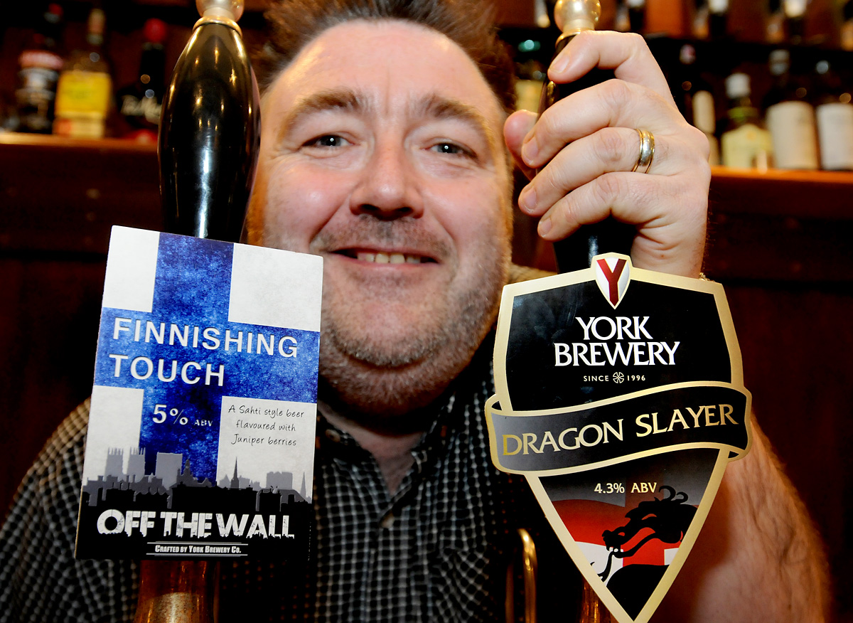 Jack Merry, of the Yorkshire Terrier on Stonegate, with the two new beers from York Brewery