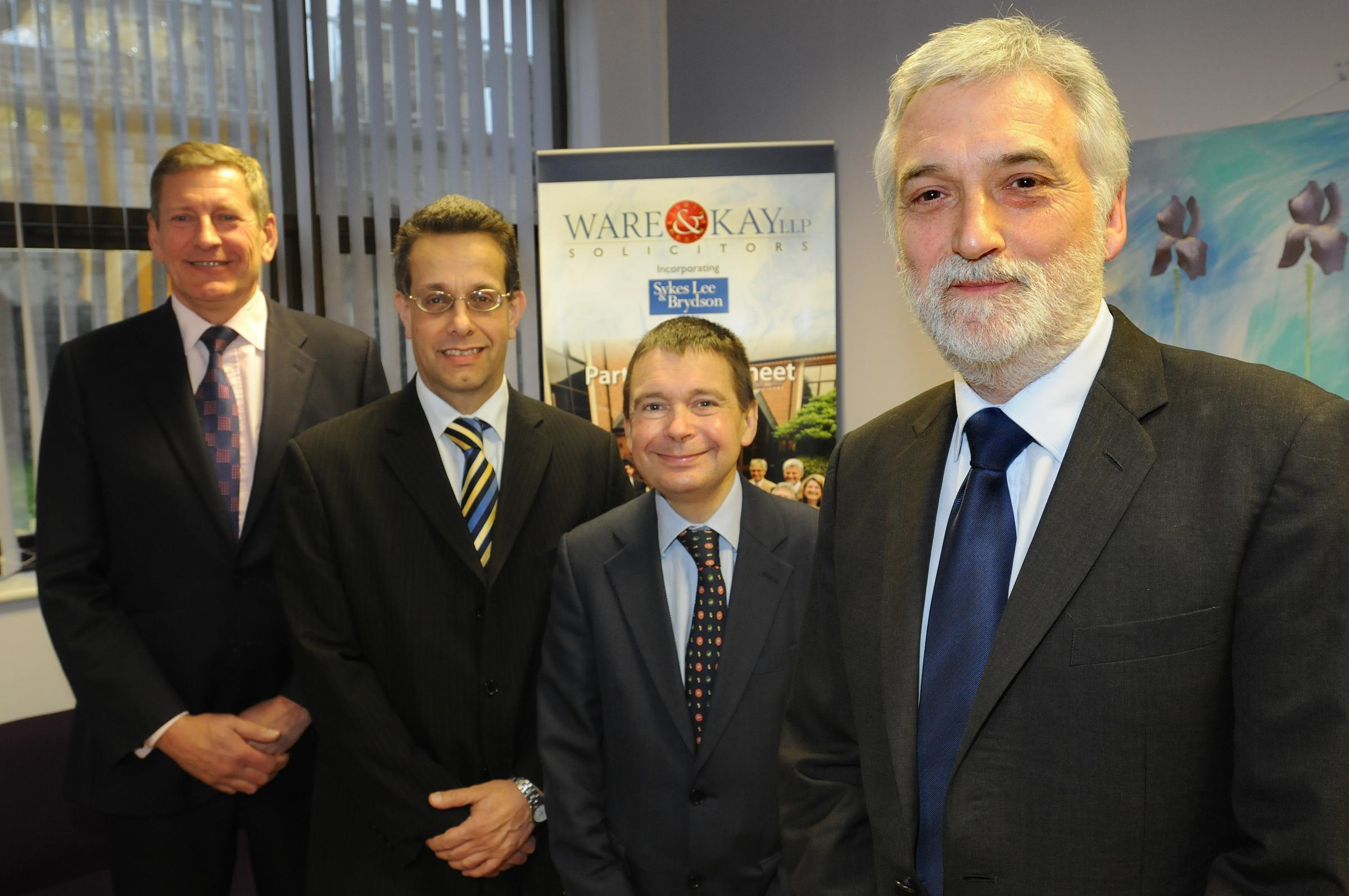 David Liddell, right, retires from Ware & Kay  Solicitors after 30 years, watched by colleagues, from left, senior partner Peter Kay, David Hyams and Steven Partridge