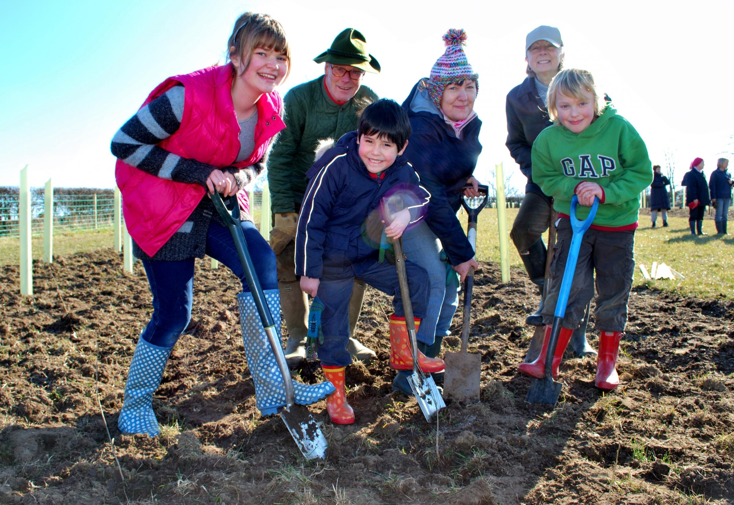 Volunteers pitch in to help plant 600 trees near Holtby, a project funded by a £2000 grant from the Two Ridings Community Foundation.