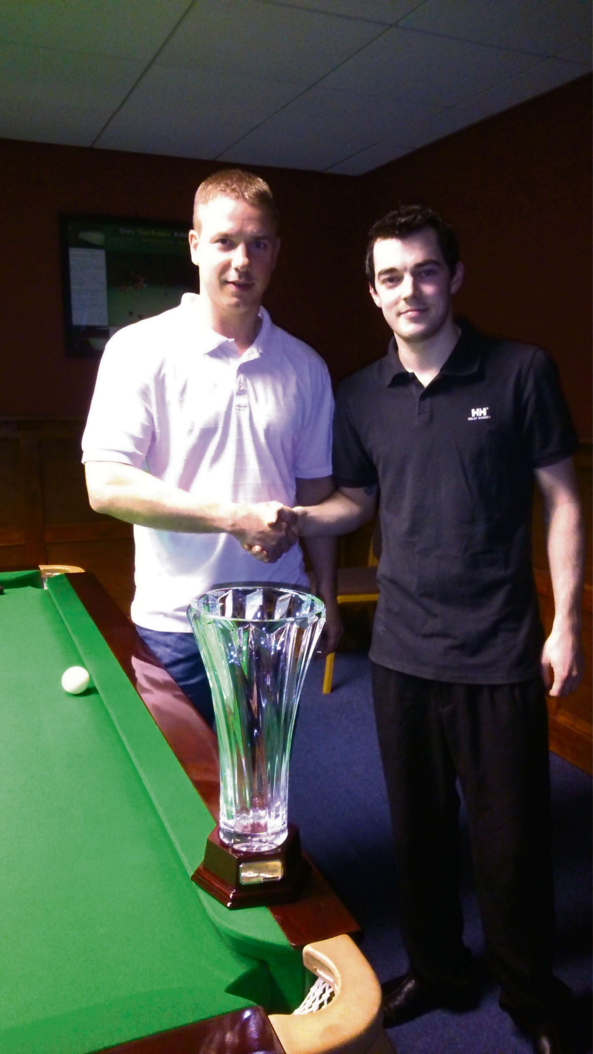 Beaten finalist Dan Potter, left, with champion Steve Gregson and the York Masters trophy