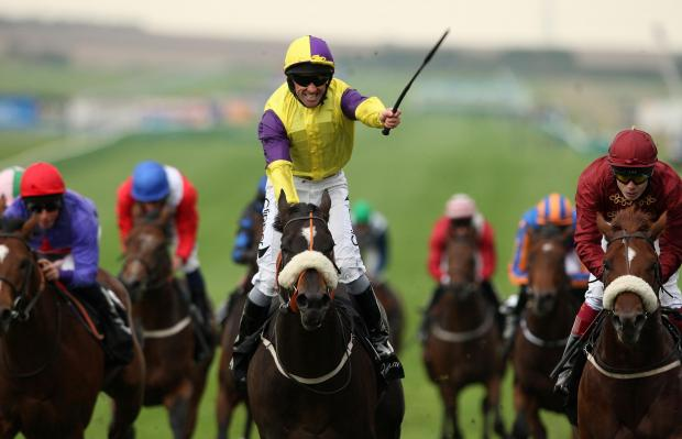 Jockey Neil Callan riding Astaire celebrates as he wins the vision.ae Middle Park Stakes during the Dubai Future Champions Day at Newmarket Racecourse.