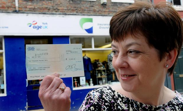 Jan Hunter of Age UK with a bankers draft for £2000 which has been donated anonymously trough the door of the Walmgate shop. Picture : Garry Atkinson (5095252)